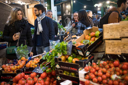 London, UK - 15 March 2020, People shop at Borough Market in Southwark, London. It is one of oldest markets in Europe. Its 1,000th birthday was in 2014. Redakční