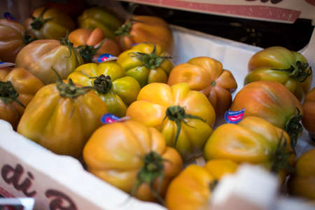 London, UK - 12 March, 2020, Large COUR DI BUE TOMATO for sale on a farmers Borough market stall
