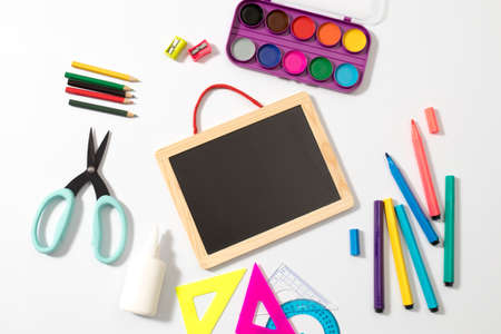 Back to School Chalkboard Sign. Education and back to school concept. stationery over wooden white background. top view, flat lay