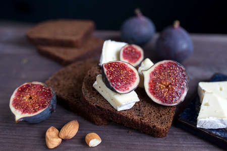 Bunch of fresh ripe figs on wodden brown background. Tropical fruit Reklamní fotografie