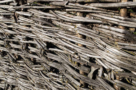Wicker fence. Abstract background texture. Wattle has long been considered a symbol of comfort and measured rural life. Banque d'images