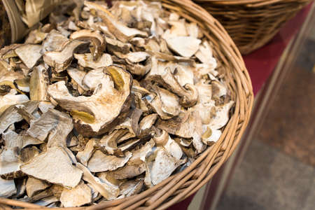 Dry mushrooms are sold in a wicker box