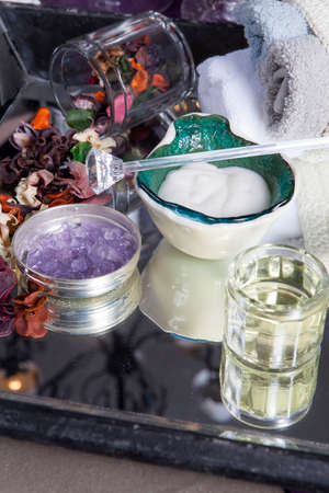 Handmade face cream in a green glazed bowl. Dry flowers for aromatizing the room Фото со стока