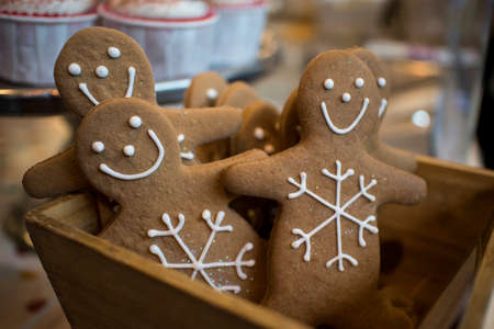 Gingerbread men in a box decorate the house
