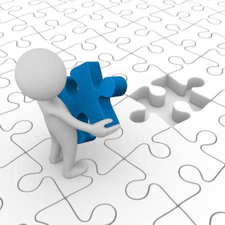 completing: Man holding the final puzzle piece Stock Photo