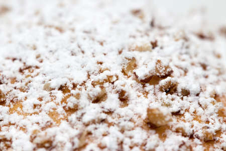 Powdered sugar on baked item