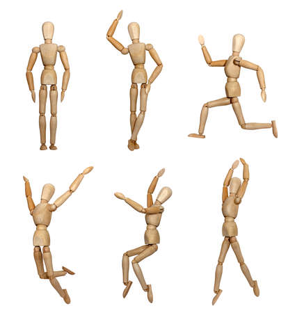 Wooden mannequins standing, sitting, running, dancing, jumping Stock Photo