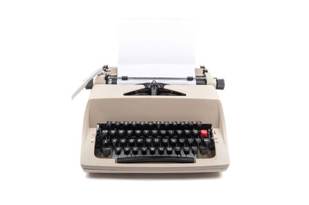 Typewriter with a sheet of paper isolated on white photo