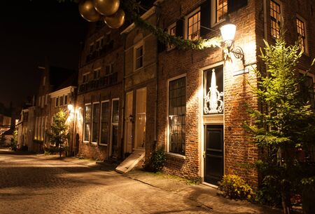 Deventer at night in a Dickens street before Christmas