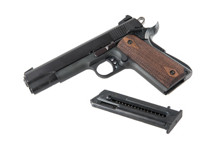 removed: Semi-automatic pistol with removed magazine isolated on white Stock Photo