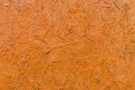 Structure of glued wood chips dyed orange Stock Photo
