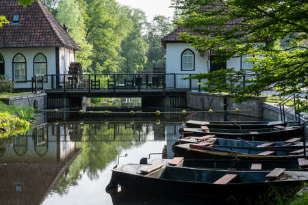 Winterswijk, may 26. Close-up of the historic watermill Den Helder with rowing boats