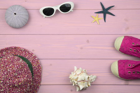 estival: overhead of summer accessories for baby girl