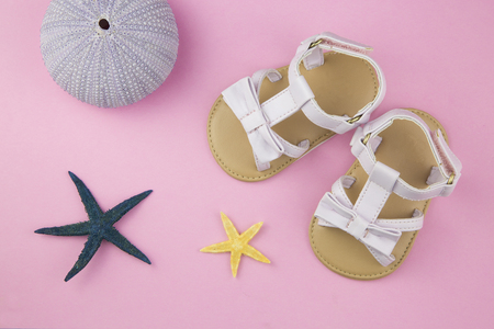 estival: overhead of a pair of baby girl sandals