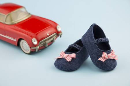 50s: portrait in 50s style of a pair of little girl shoes