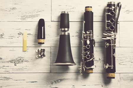 dismounted: overhead of a disassembled clarinet on wood top