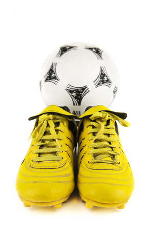 football shoes: over-white portrait of a pair of football shoes