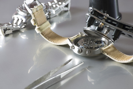 watchmaker: macro of replacing a watch battery with watchmaker tools Stock Photo