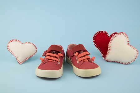 portrait of little girl shoes with hearts Stock Photo
