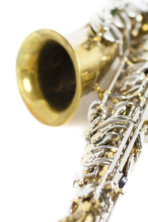 detail of a gold and silver brass saxophone in white background