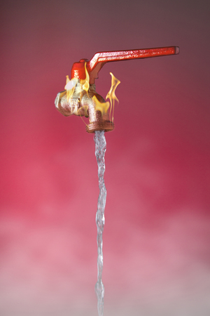 Faucet from which water flows so hot it generates a flame
