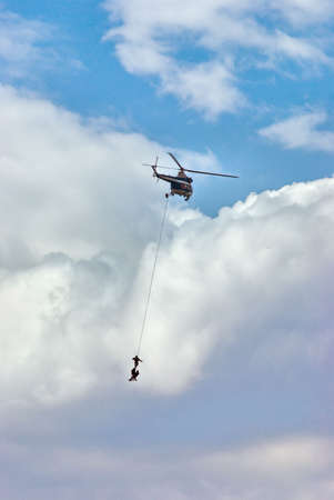 Helicopter on the cloudy background with special forces photo