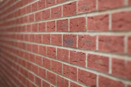 Newly build brwon brick wall shot close up photo