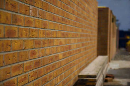 Newly constructed brick wall on construction site photo