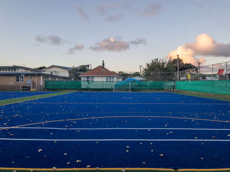Blue artificial turf hockey court lies vacant and empty during the pandemic lock down in Auckland New Zealand