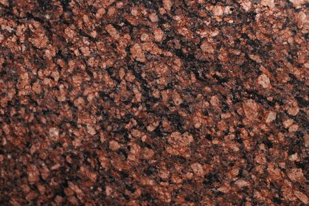 Granite texture of red color. Granite surface for background, material for decorative texture, interior design.