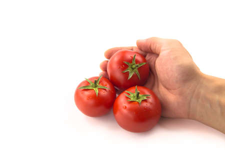 domates: Three Tomatoes With Hand - Clipping Path Inside Stock Photo