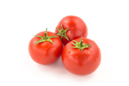 domates: Three Tomatoes With Water Drops  Stock Photo