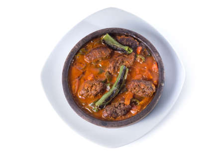 Meatball on traditional Turkish tile plate, tile kofte - Clipping path inside