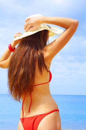tanga: vista femminile di bagnato, su un fondo del mare tropicale