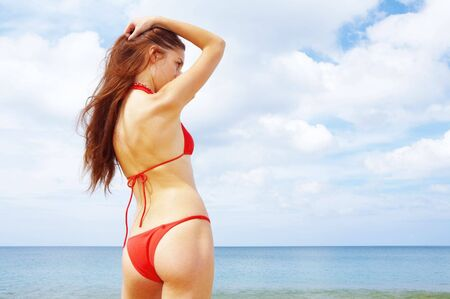 beach wrap: view of  wet female back on a background of the tropical sea Stock Photo