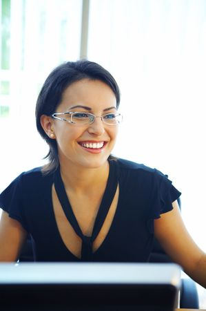entrepeneur: view of nice operator in stylish glasses at her working place Stock Photo