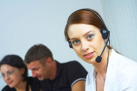 portrait of a friendly secretary/telephone operator in an office environment. Stock Photo - 2298963