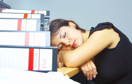 working place: portrait of a woman dozing on her working place