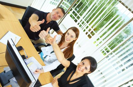workgroup: view of workgroup posing in a natural work environment Stock Photo
