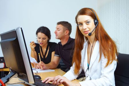 portrait of a friendly secretary/telephone operator in an office environment. Stock Photo - 2299129