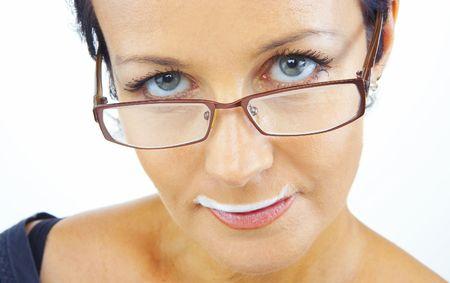 milk mustache: portrait of woman wearing funny mustache on white back