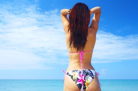 endlessness: view of  wet female back on a background of the tropical sea Stock Photo