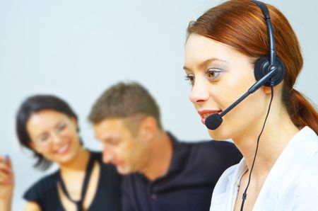 portrait of a friendly secretary/telephone operator in an office environment. Stock Photo - 2299364