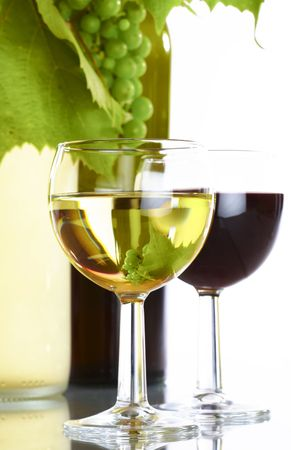 view of  wine bottle with vine and  full wineglasses  on white back Stock Photo