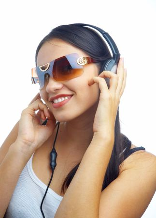 view of young nice girl listening music via earphones Stock Photo - 2299415