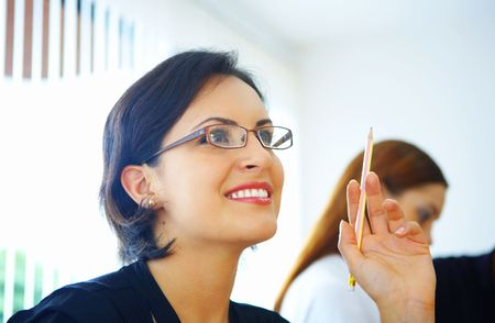 entrepeneur: Portrait of nice young businesswoman in office environment Stock Photo