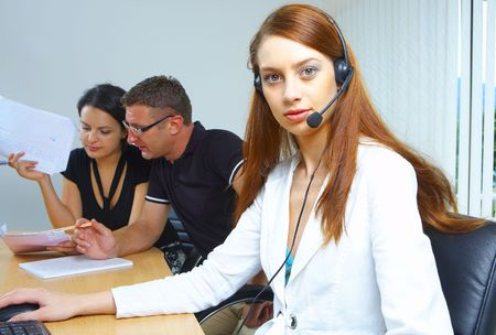 portrait of A friendly secretary/telephone operator in an office environment. Stock Photo - 2299464