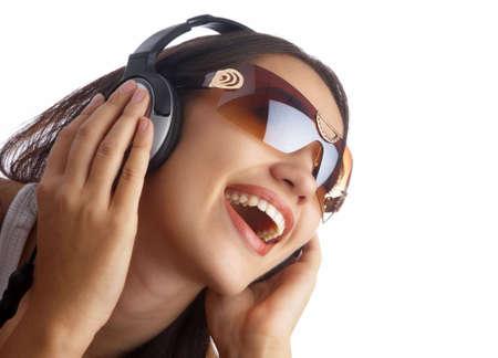 nice girl: view of young nice girl listening music via earphones Stock Photo