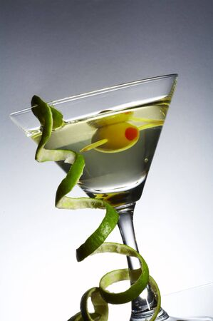 vermouth: view of  martini glass with vermouth and curl of lime rind