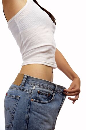 view of female became skinny  and wearing old jeans  Stock Photo